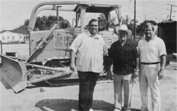 Steve, Freddy & Ed Durr in front of a bulldozer