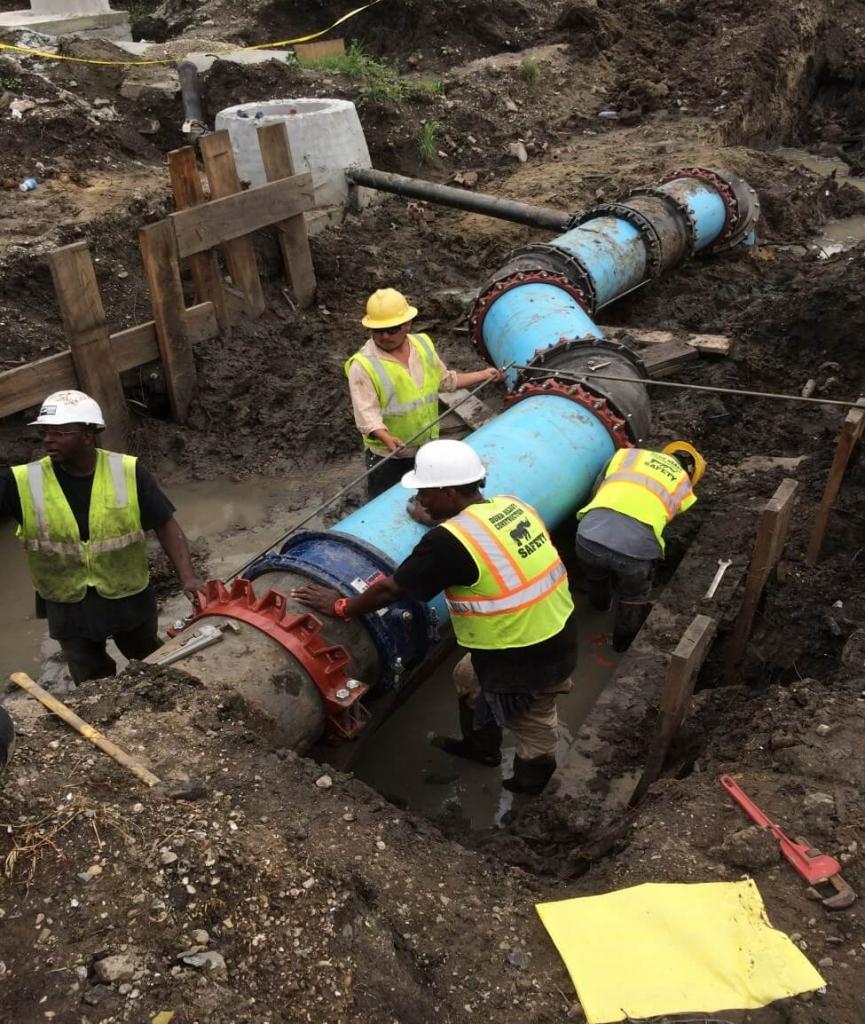 durr construction workers installing utilities