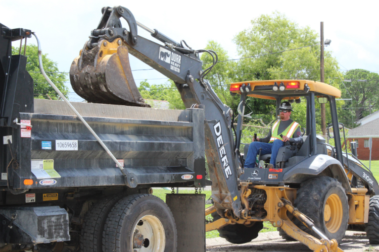 a worker operates heavy equipment on a job site