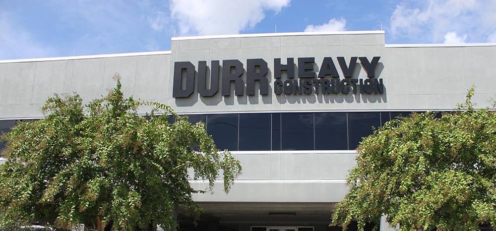 the front facade of the Durr building showing the Durr Heavy Construction sign