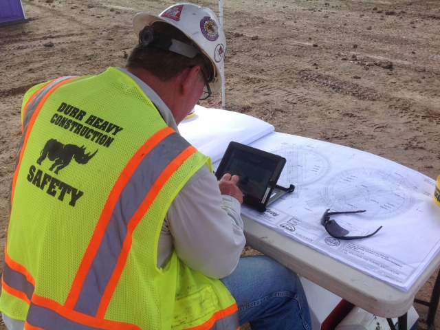 an engineer reviews plans while utilizing an ipad