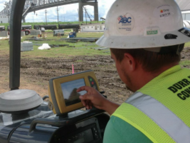 an engineer utilizes a gps system by touching the screen