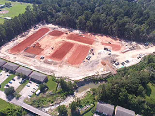a drone shot of the university grande site