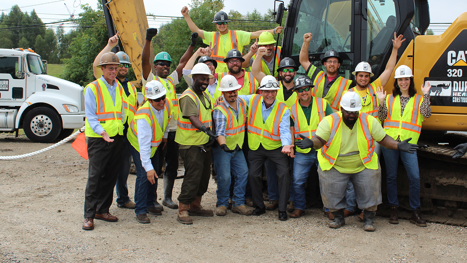 a group of durr employees pose for a photo
