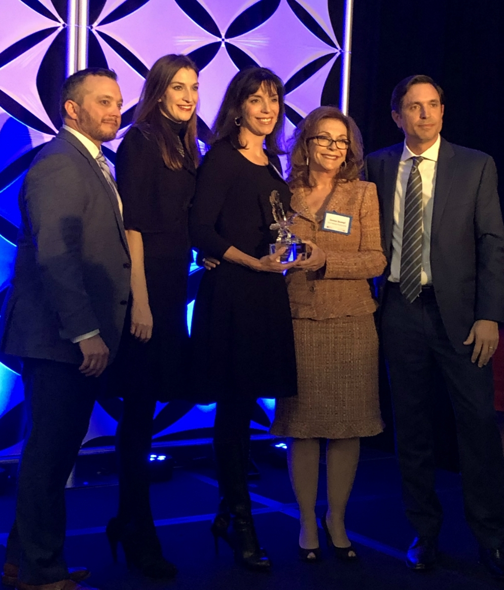 The Stumpf Family, Stevie, Dana, Shana, and Donna, pose with a LABI spokesperson holing an award