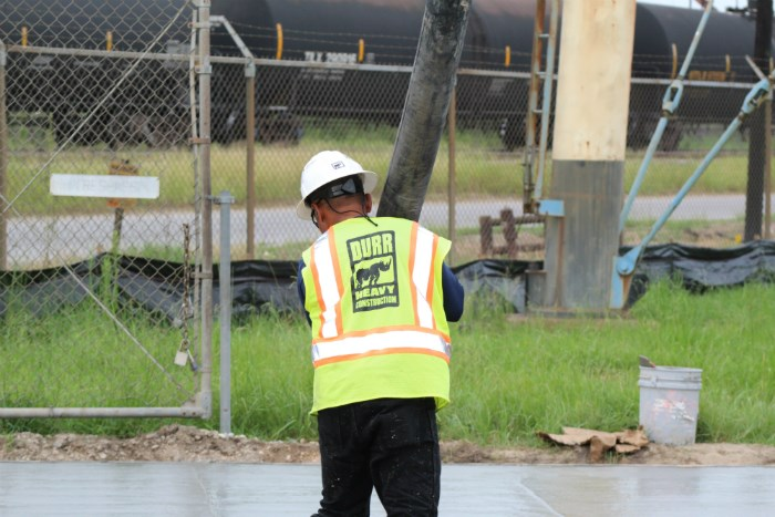 a durr worker guides a concrete pump