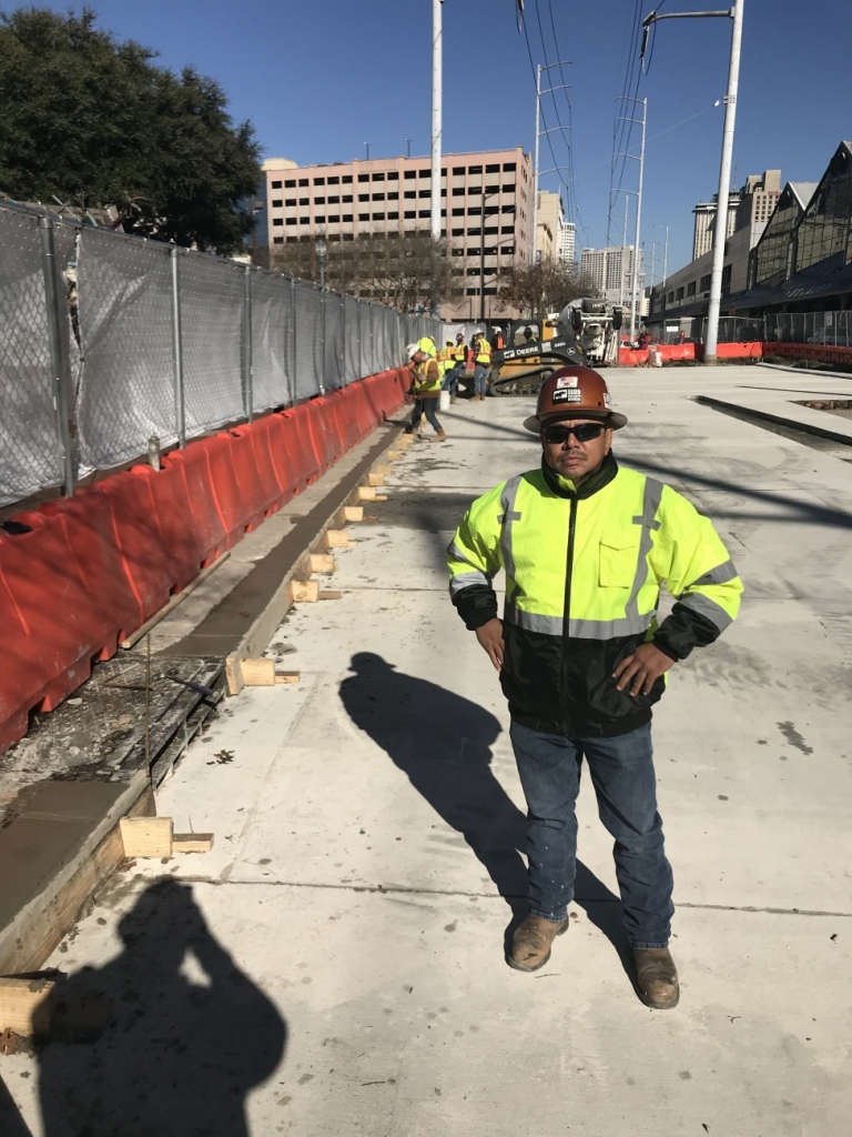 a construction worker standing in front of a job site