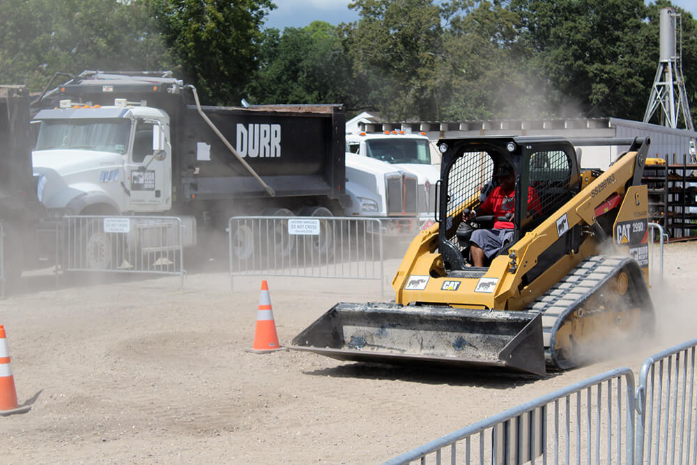 A skidsteer driving between cones