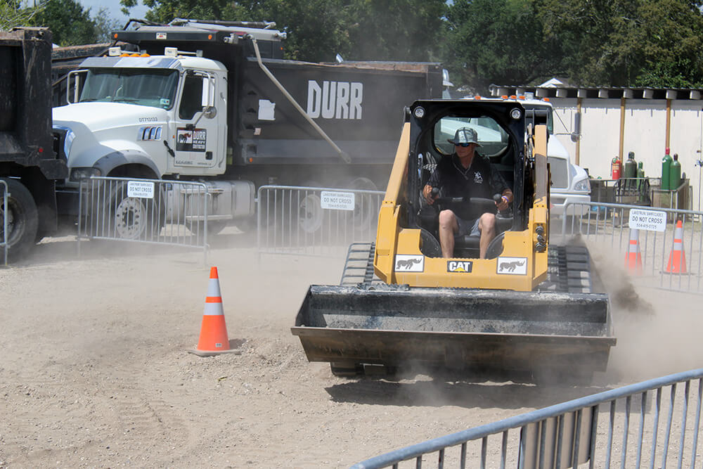 A skidsteer in an obstacle race