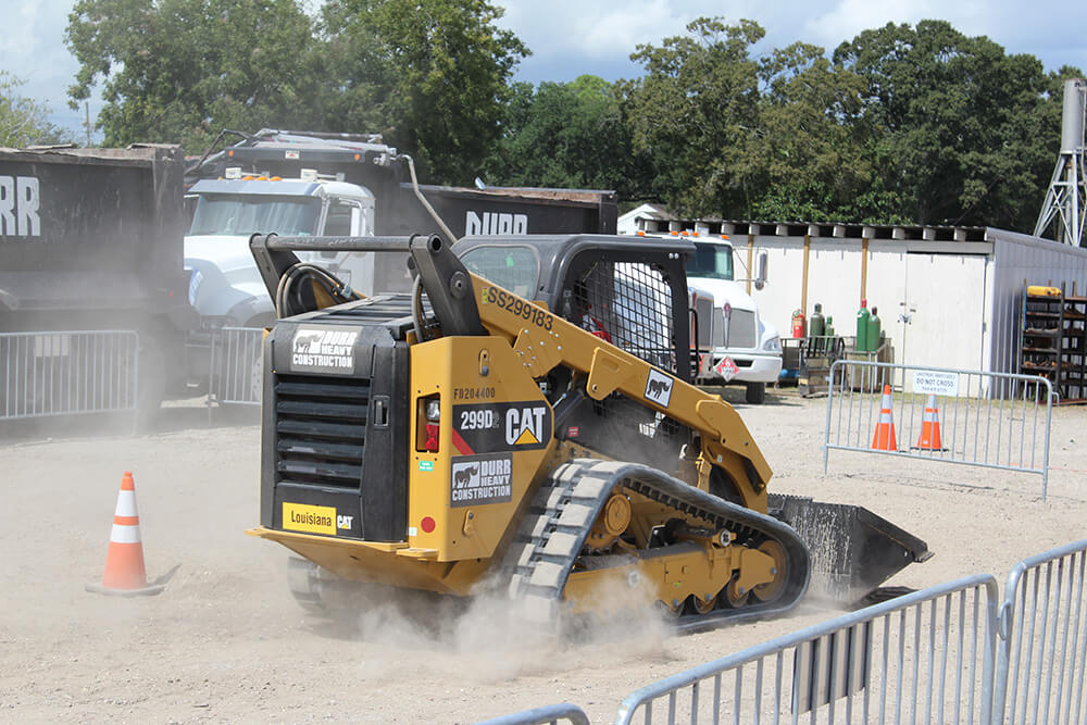 A skidsteer in an obstacle course