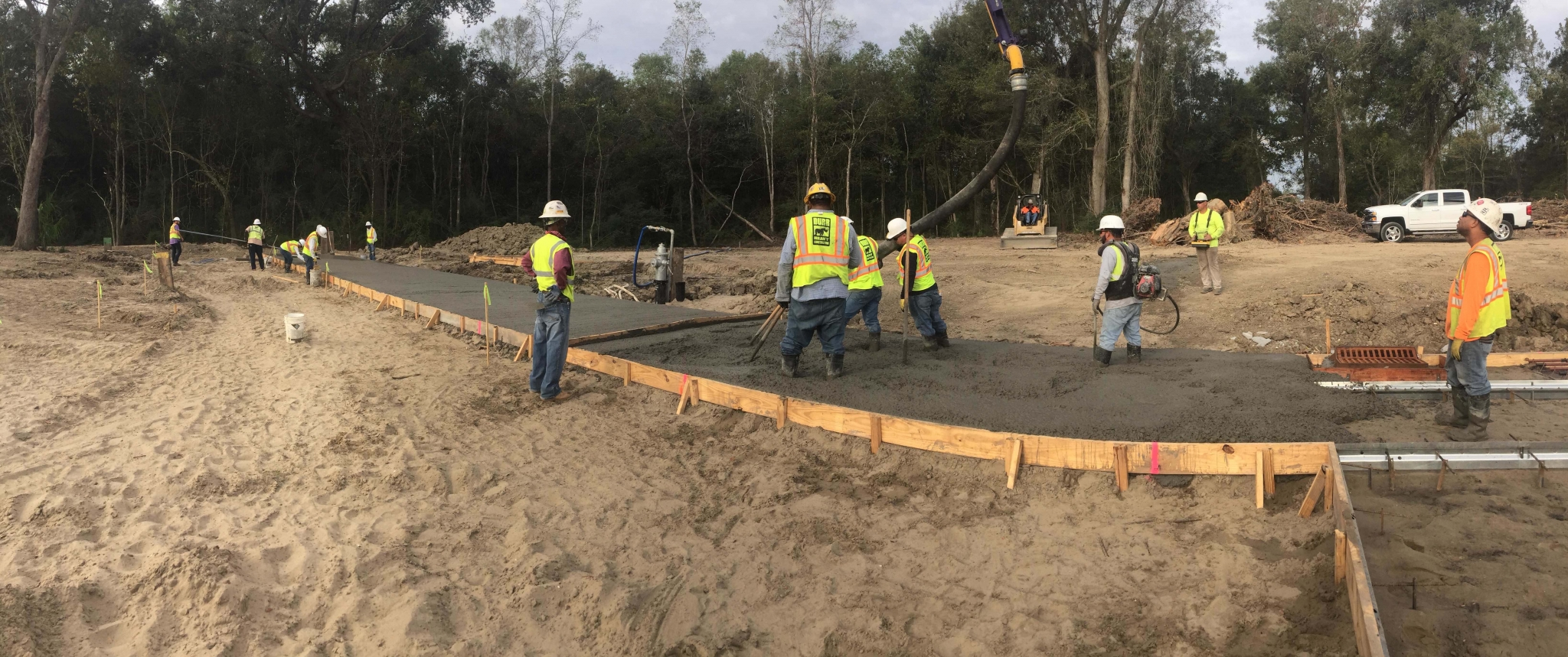 workers smooth out poured concrete