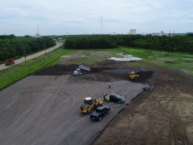 drone shots of trucks and equipment at a jobsite
