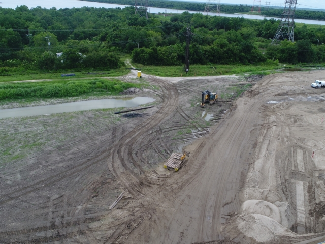 a drone shot of an excavator on a large job site