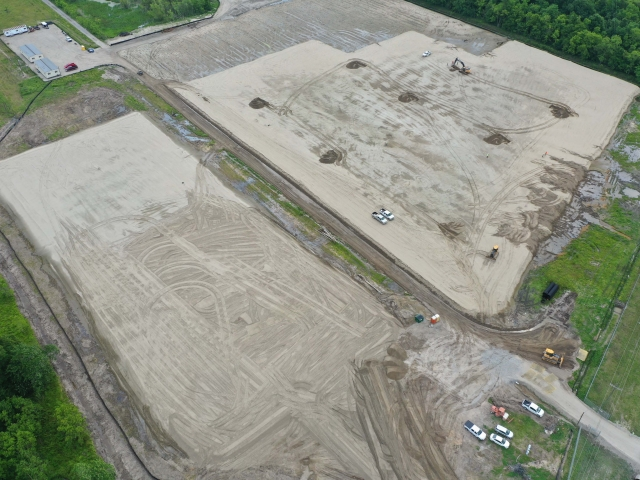a topdown view of two job sites next to each other. the ground is newly smoothed out