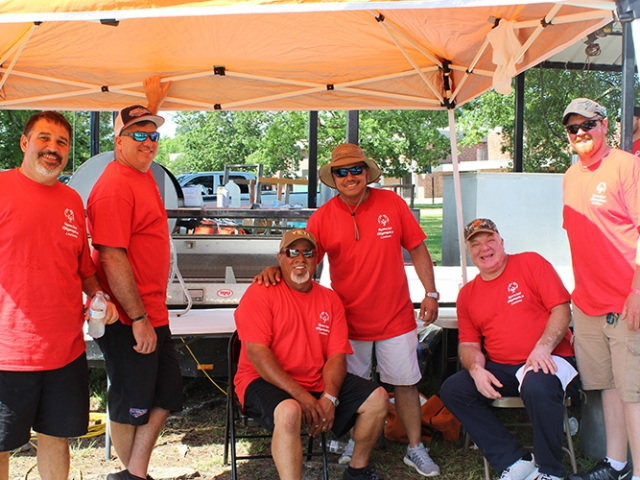 durr volunteers pose near the cooking area for special olympics louisiana