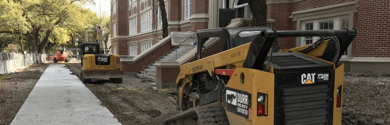 Construction vehicle outside of a high school building