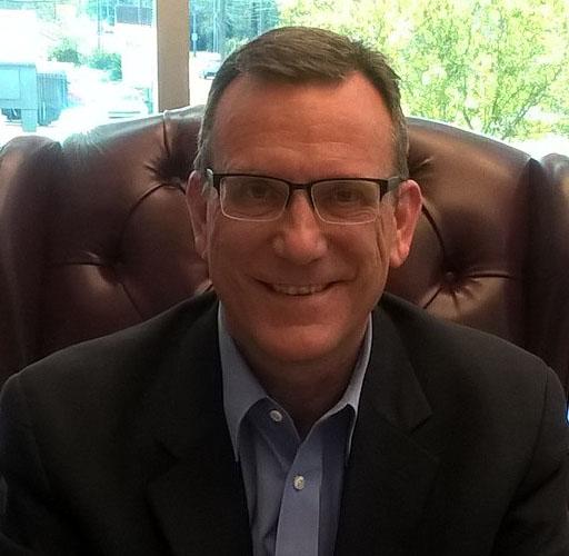 A headshot of Robert S Wooderson