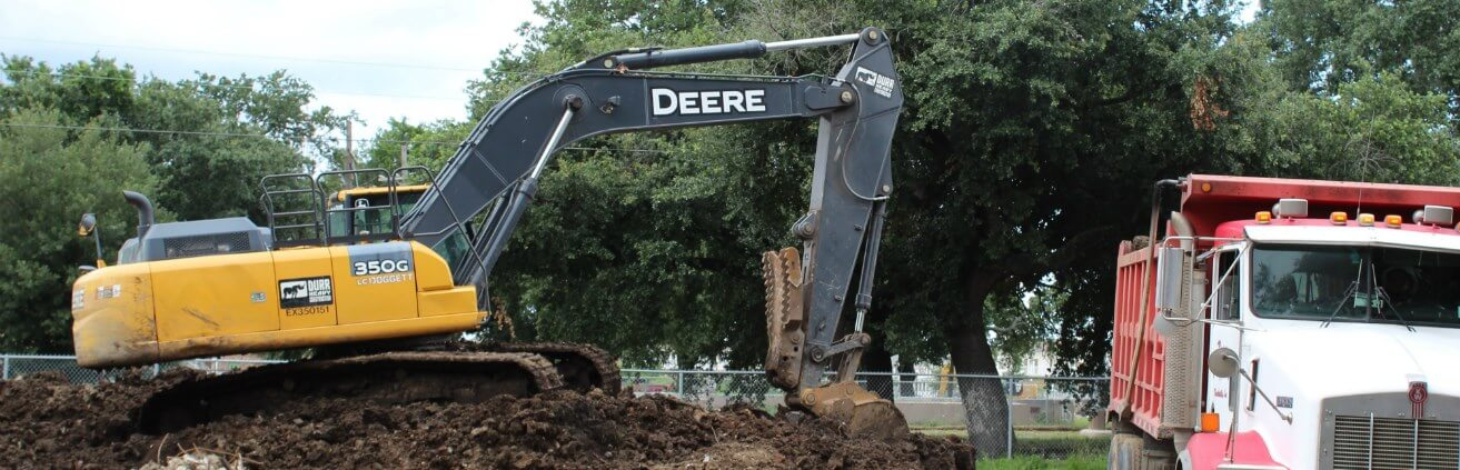An excavator and construction truck