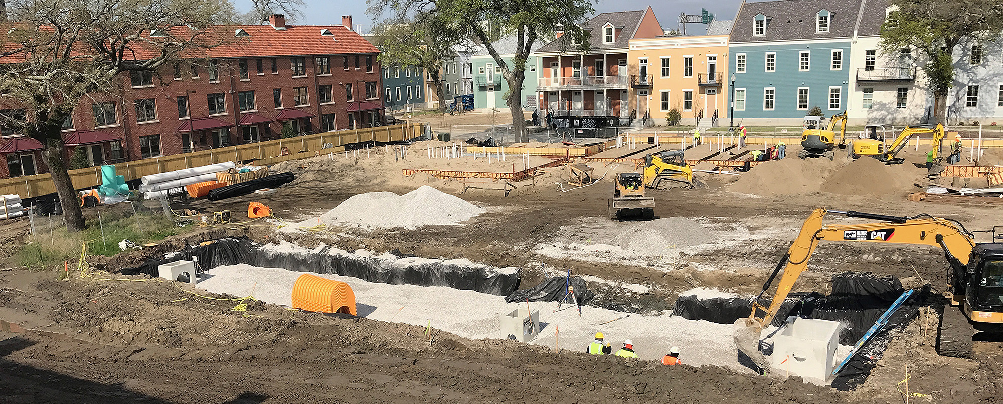 Excavators dig out the ground to install utilities