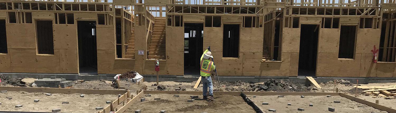 a worker preps the site for a concrete pour