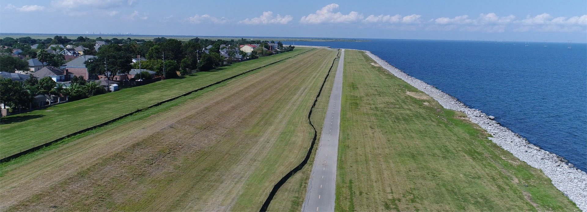 drone shot of the kenner levee with the mississippi river in the background