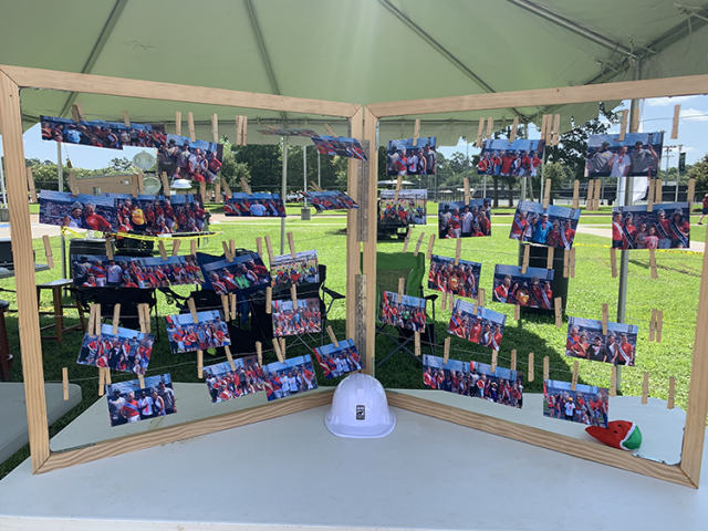 a photo stand shows off the many photos taken at special olympics louisiana