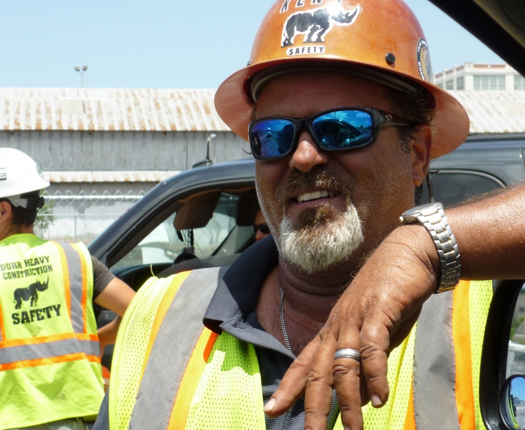 "A Durr employee with the word ""safety"" showing on his hard hat"