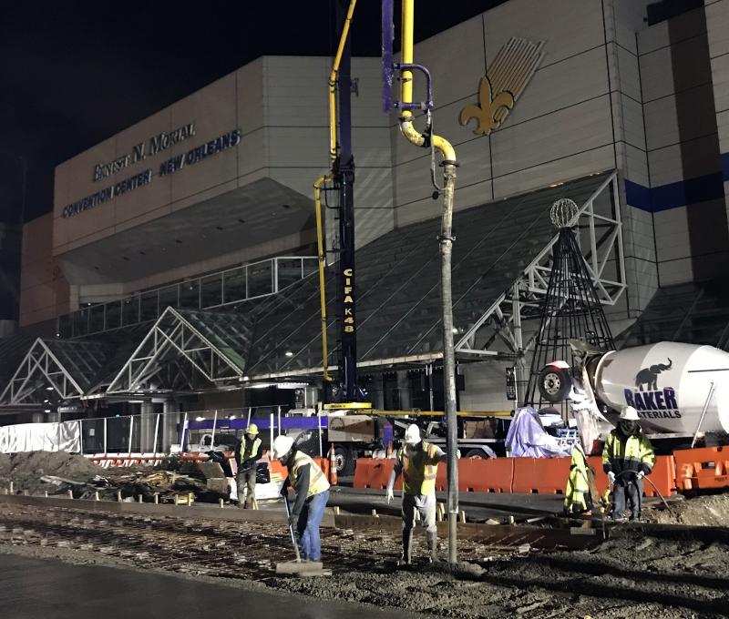 a crew pours concrete at the New Orleans Convention Center